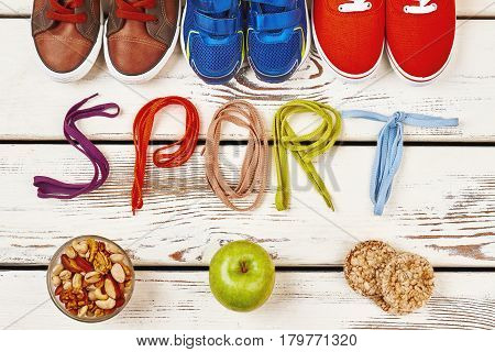 Nuts, sport footwear and shoelaces. How to maintain health.