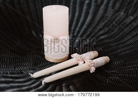 Wedding decorated candles with the bowknot in the tenderly light pink style