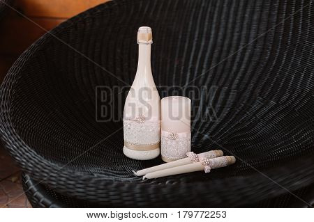 Wedding decorated candles and champagne with the bowknot in the tenderly light pink style