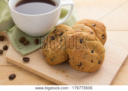 Closeup of chocolate cookies and a cup of coffee