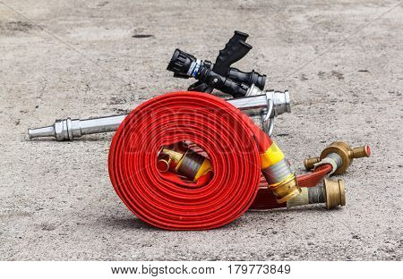 The Fire equipment extinguishers watercourse fire extinguisher red ready to use in the outdoor.