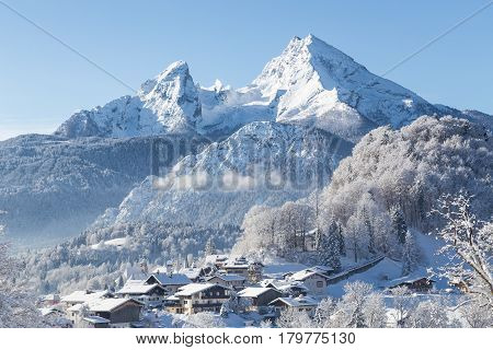 Winter wonderland scenery with the historic town of Berchtesgaden and Watzmann mountain in the Alps Bavaria Germany