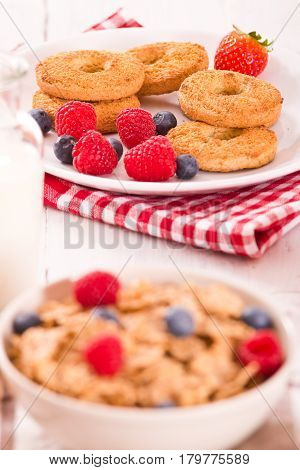 Breakfast with wholegrain cereals on white dish.