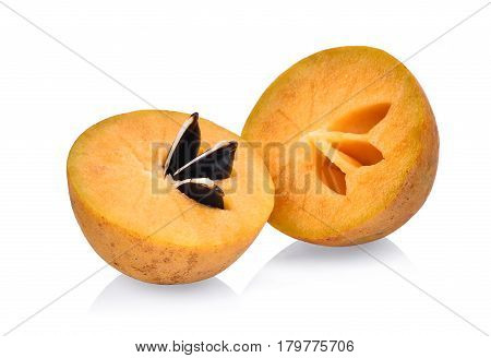 half of fresh sapodilla isolated on white background