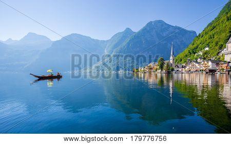 Hallstatt Lakeside Town With Traditional Platte Boat In Summer, Salzkammergut Region, Austria