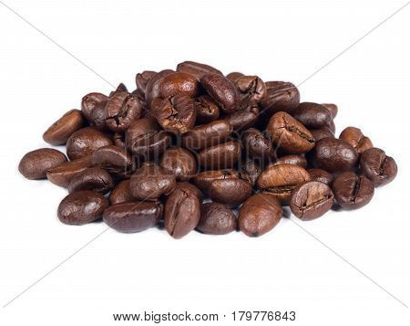 Roasted coffee grains on white isolated background from close up view