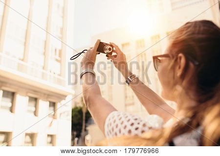 Young Tourist Recording Selfie In A Street Surrounded By Buildin
