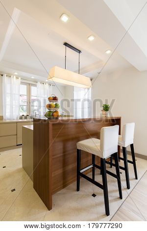 Wooden Bar Table In An Elegant Kitchen