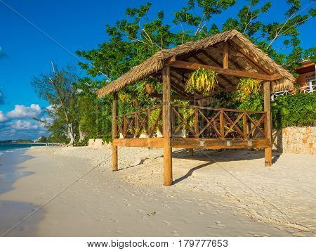 wooden hut with suspended plant pots on Seven Mile Beach,Cayman Islands