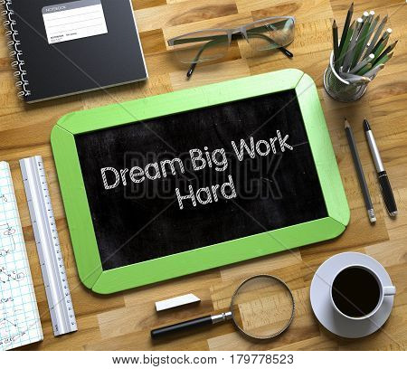 Small Chalkboard with Dream Big Work Hard Concept. Top View of Office Desk with Stationery and Green Small Chalkboard with Business Concept - Dream Big Work Hard. 3d Rendering.