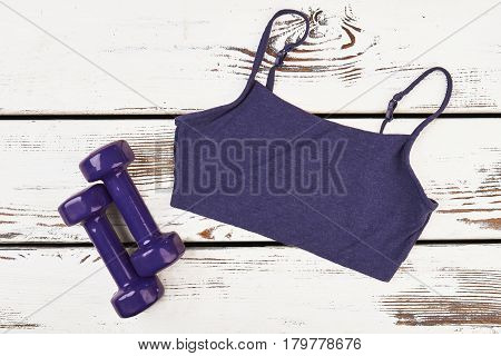 Tank top and dumbbells. Healthy active lifestyle.