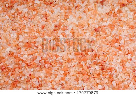 Background of coarse pink Hymalayan salt close-up view from above