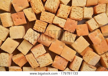background of croutons dried bread pieces. food texture