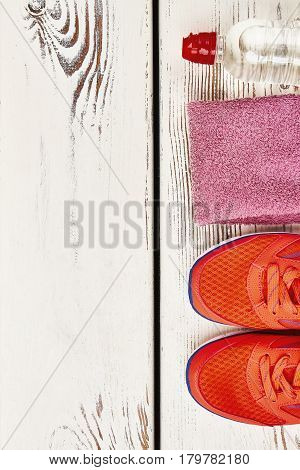 Sport shoes, towel and water. Be positive and energetic.