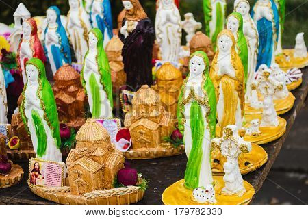 Photo of the Statues the Virgin Mary. Traditional Easter market in Yerevan. Easter decoration. Retail trade. Souvenirs church, cross, jesus