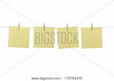 Notes or posit hanging wooden pegs, on white background