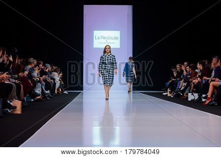 MOSCOW RUSSIA - MARCH 22 2017: Model walk runway for LA REDOUTE & PLUS SIZE MOSCOW catwalk at Autumn-Winter 2017-2018 Moscow Fashion Week. Plus-size fashion models.