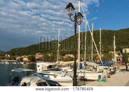 VASILIKI, LEFKADA, GREECE JULY 16, 2014: View at sunset on the promenade in Vasiliki, Lefkada, Ionian Islands, Greece