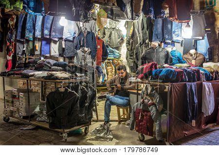Urmia, Iran - December 2, 2015: Unidentified iranian man sell clothes on the street of Urmia, Iran