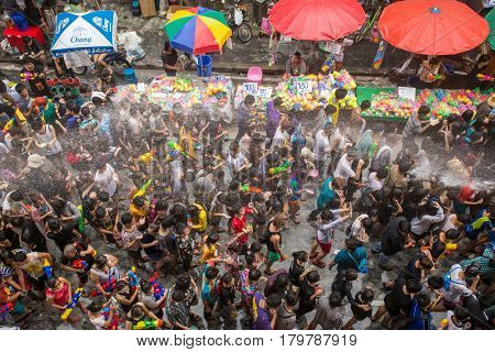 Bangkok, Thailand - April 13, 2014 : The Songkran festival or Thai New Year's festival on Silom street in Bangkok, Thailand.