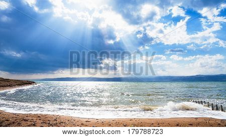 Sunbeams Passes Through Blue Clouds Over Dead Sea