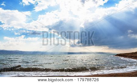 Sunshine Passes Through Blue Clouds Over Dead Sea