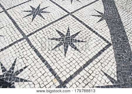 Typical stone floor Lisbon detail of a typical floor with shapes and drawings art Portugal tourism