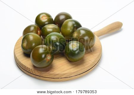 Tomate kumato on a table for the kitchen