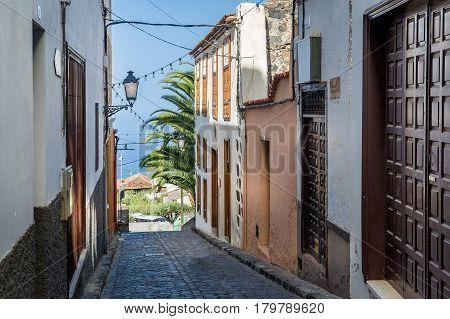 Icod de los Vinos street is going down the hill to the ocean coast. Tenerife island, Canaries, Spain.