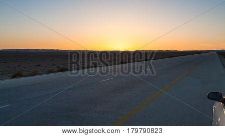 Sunset Over Desert Highway (road 15) In Jordan