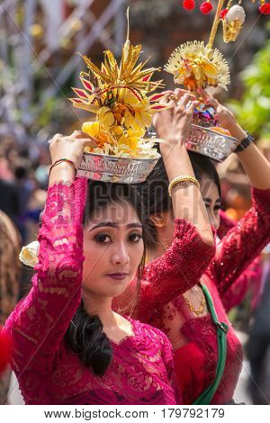 Bali, Indonesia - August 20, 2016: Unidentified balinese women with offerings during ceremony of royal cremation in Ubud, Bali