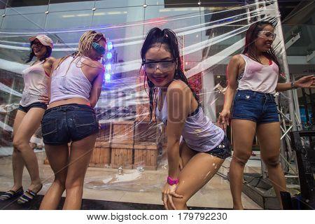 Bangkok, Thailand - April 13, 2014 : The Songkran festival or Thai New Year's festival on Silom street in Bangkok, Thailand.