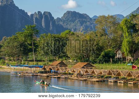 Vang Vieng, Laos - January 19, 2017: Nam Song River landscape with a speedboat in Vang Vieng, Laos