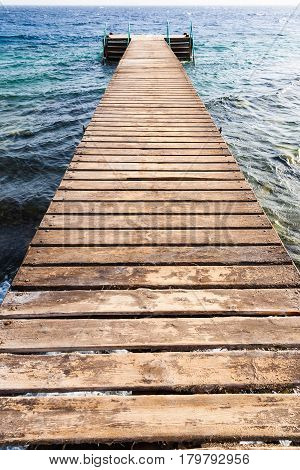Wooden Pier On Coral Beach Of Red Sea In Aqaba