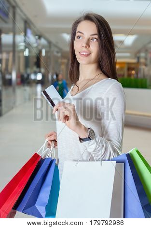 Beautiful Girl Holding A Credit Card In A Shopping Centre