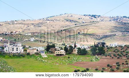 Village And Terraced Gardens In Jordan In Winter