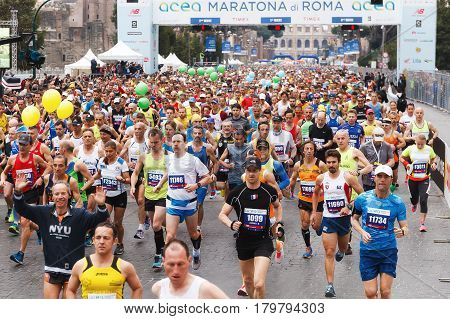 Rome Italy - April 2 2017: the departure of the athletes on Via dei Fori Imperiali the Coliseum on background.