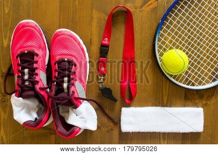 Set of things for playing tennis on a wooden background