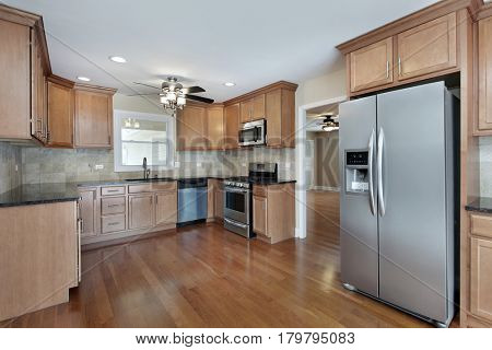 Kitchen in suburban home with cherry wood cabinetry.