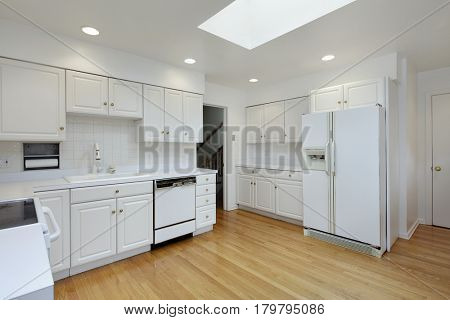 Kitchen in suburban home with white cabinetry.