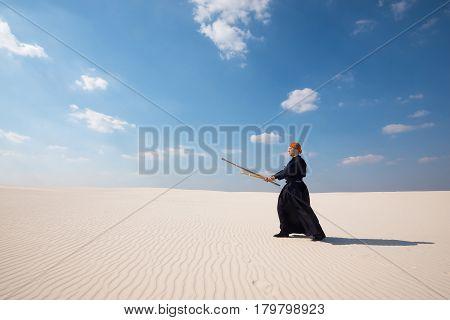 Caucasian Man With Shinaiin A Desert