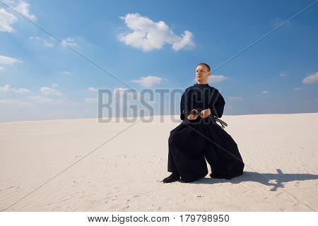 Calm Man Practicing Martial Arts In A Desert