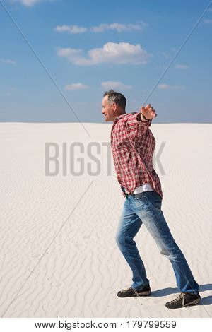 Happy Man With Open Arms In Desert