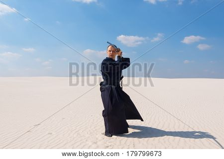 Confident Man In Traditional Japanese Clothes Practicing Martial Arts