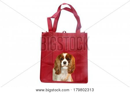 Reusable shopping bag with a King Charles Cavalier dog photo on the side.