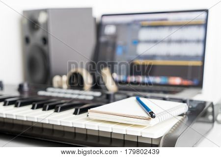 Blank notebook on music studio for song writing
