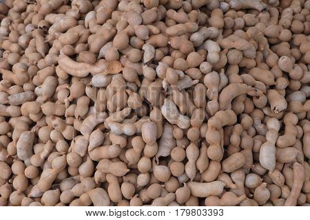 Tamarind ― the Indian date - exotic fruit it resembles the same bean, only brown color superficially.
