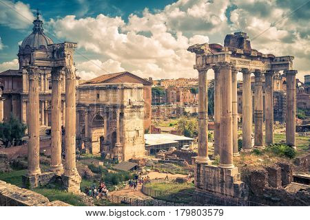 Roman Forum in Rome, Italy. Ruins of Temple of Saturn and Arch of emperor Septimius Severus.