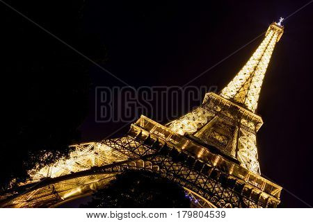 PARIS - SEPTEMBER 24, 2013: Lighting of the Eiffel tower at night. The Eiffel tower is one of the major tourist attractions of France.