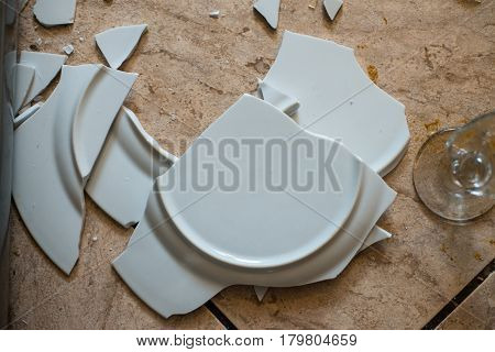 Close Up On Broken Dishes On The Floor